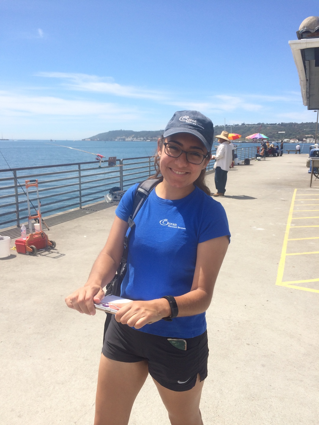 Intern Lupita Sandoval at Shelter Island pier on a sunny Monday in April. Photo taken by Nina Venuti.
