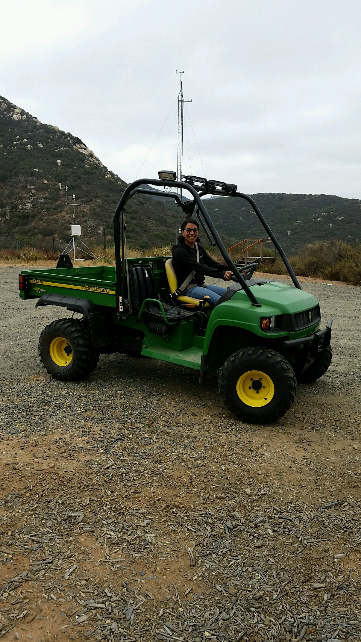 Mayra Molina  in a gator headed down the valley to pick up water samples from the field team. Image: Carly Beck