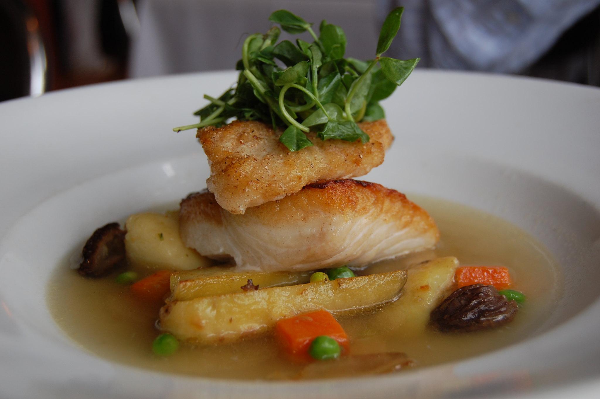 halibut with potatoes, broth, and garnish