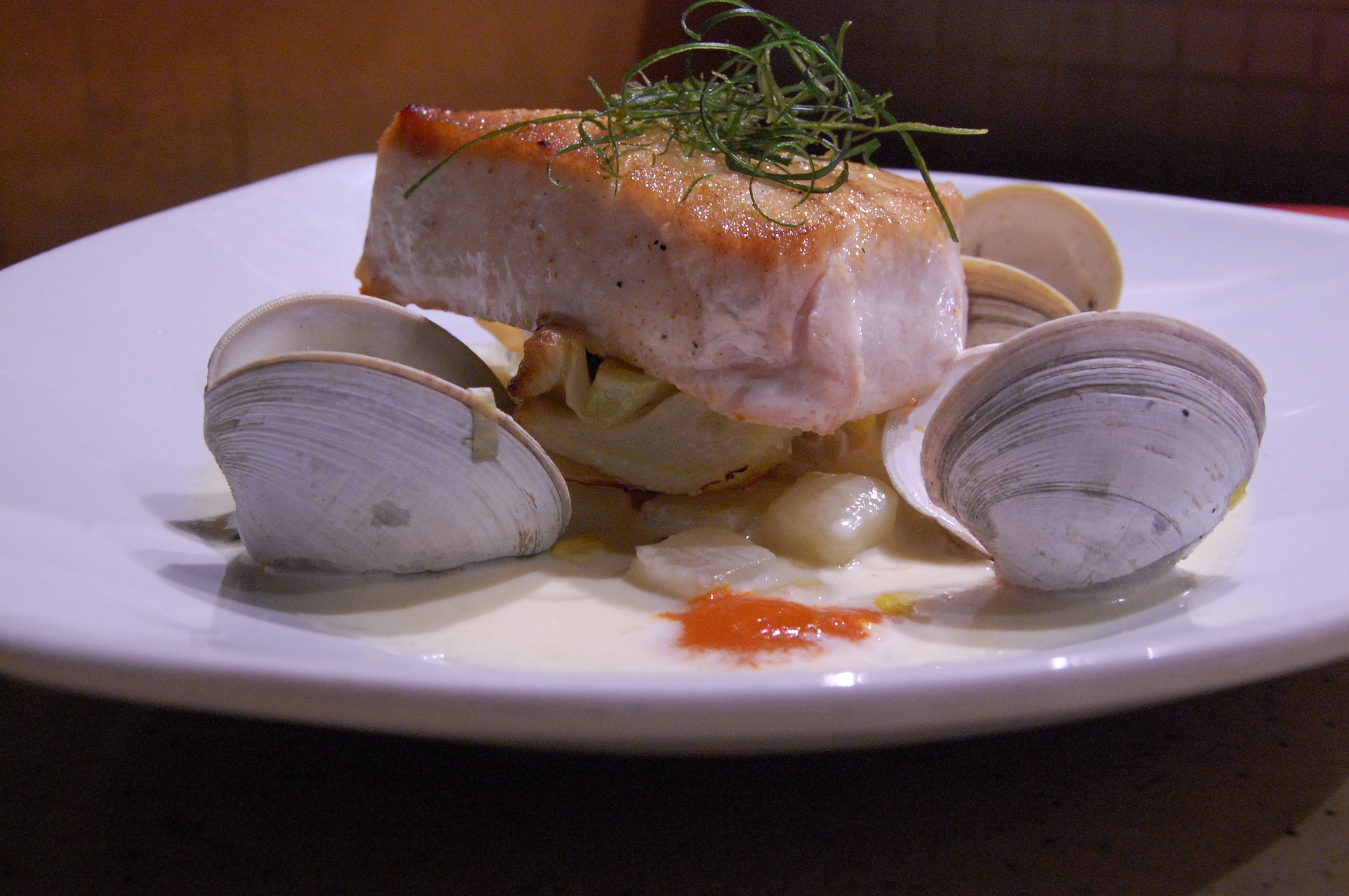 escolar with clams and garnish
