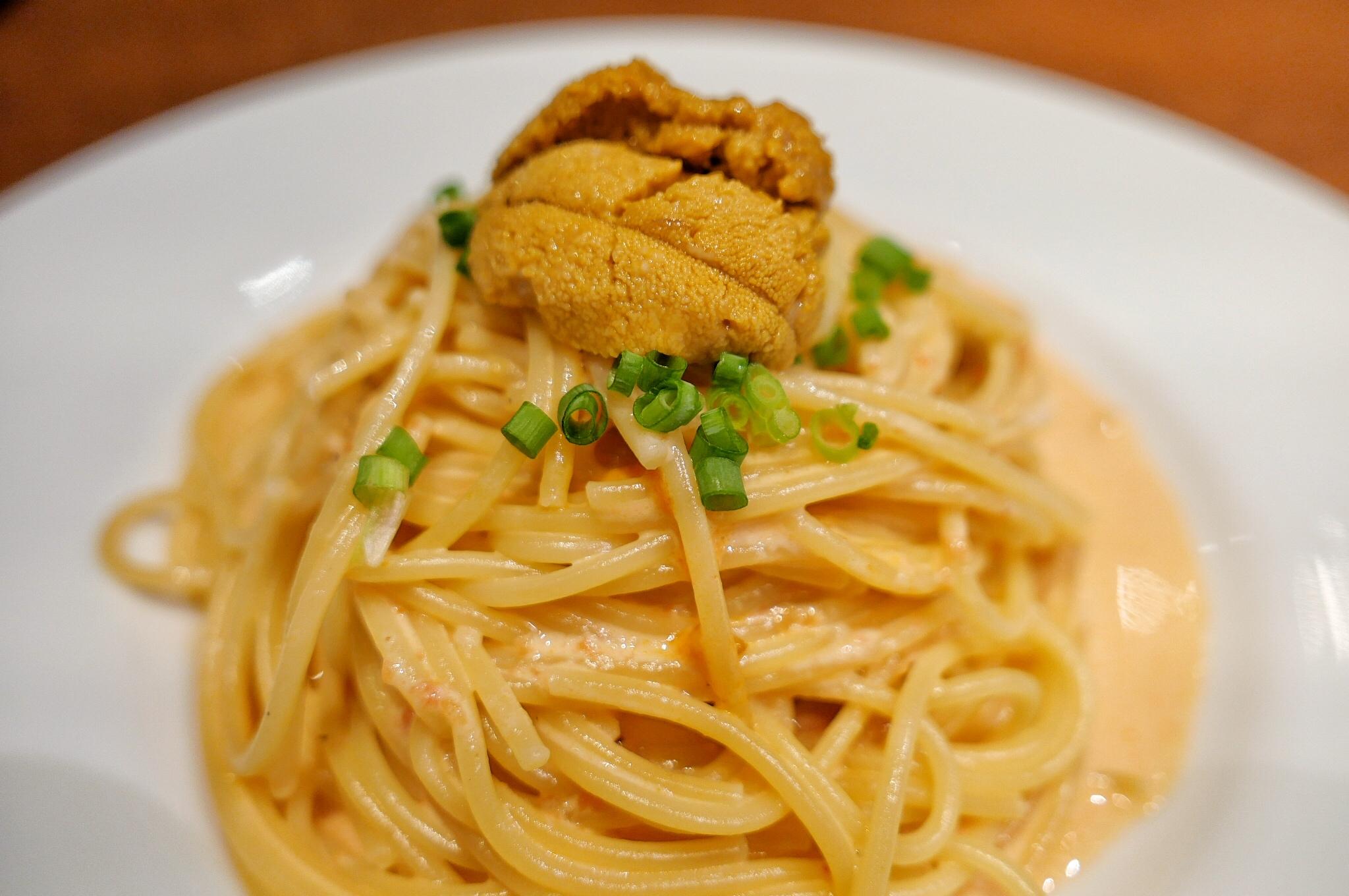 Uni pasta with green onion garnish