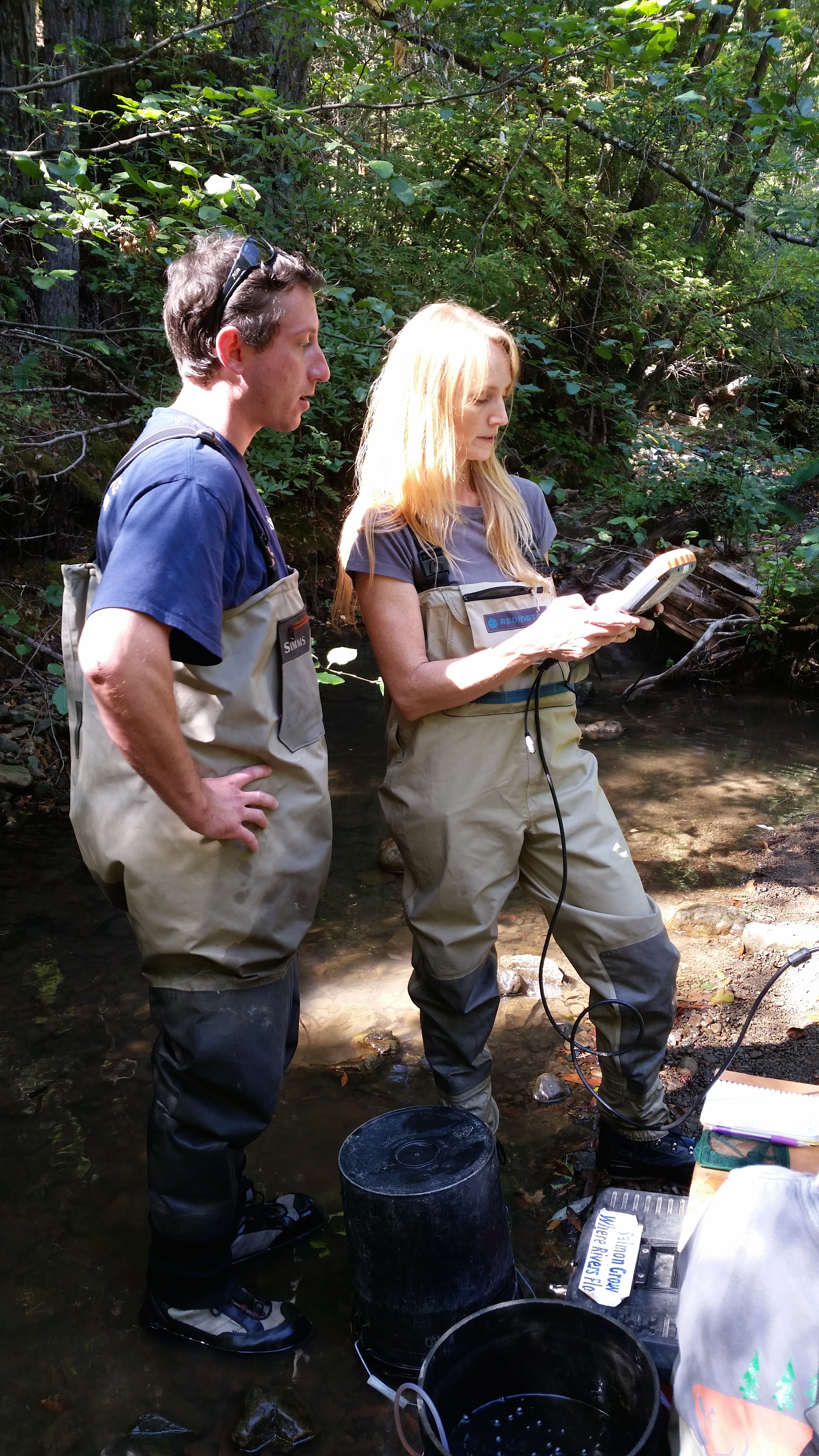 Fisheries biologists Andrew Bartshire and Sarah Nossaman Pierce of California Sea Grant monitor water quality in Mill Creek in October 2015. Photo Credit: California Sea Grant