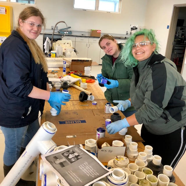Katrina Herrmann, Kayla Roy, Helaina Lindsey, and Walan Chang hard at work creating the plumbing for the experimental setup.