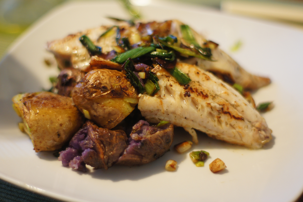 perch fillets with rainbow potatoes and green onion garnish