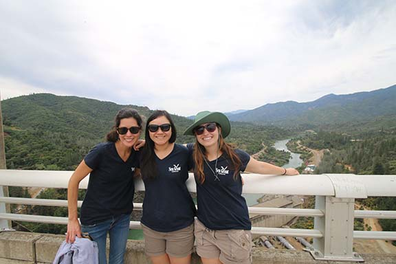 State Fellows Lauren Yamane, Monica Oey, and Annie Adelson at the Shasta Dam