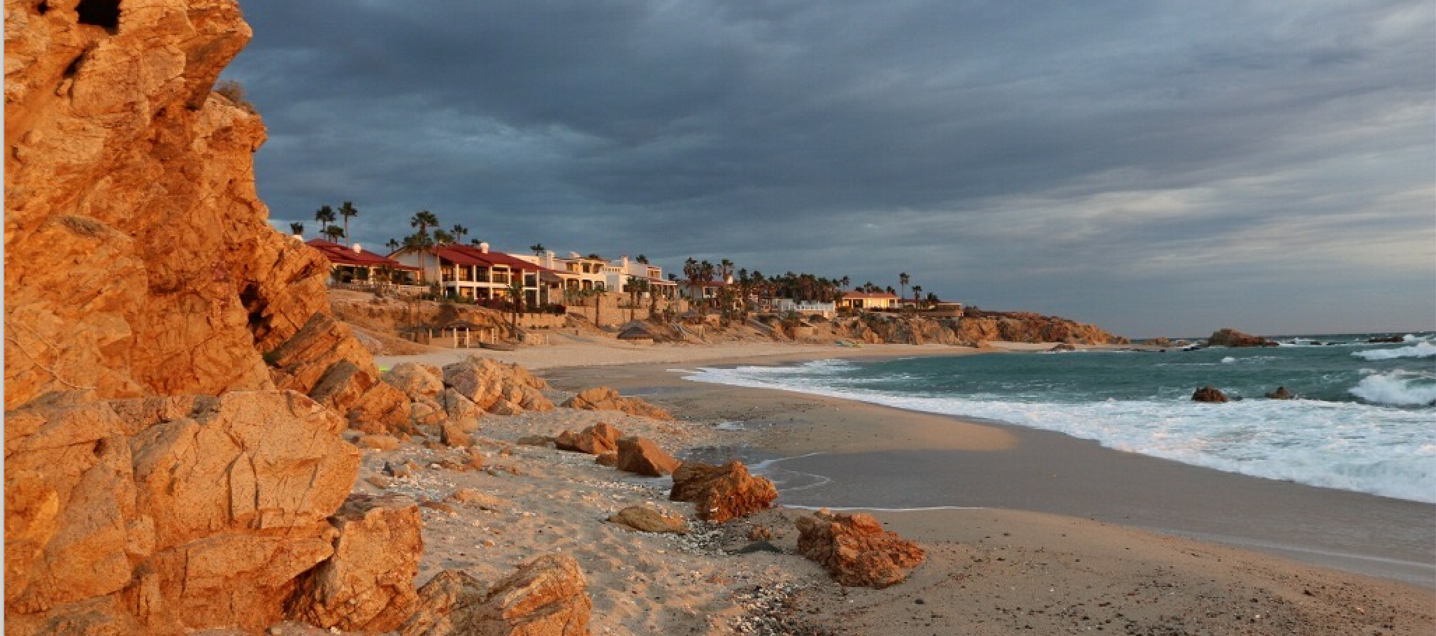 A photo overlooking a beach in Cardiff, California displaying the cliffs, beach, and coastal homes. Image courtesy of project interviewees.