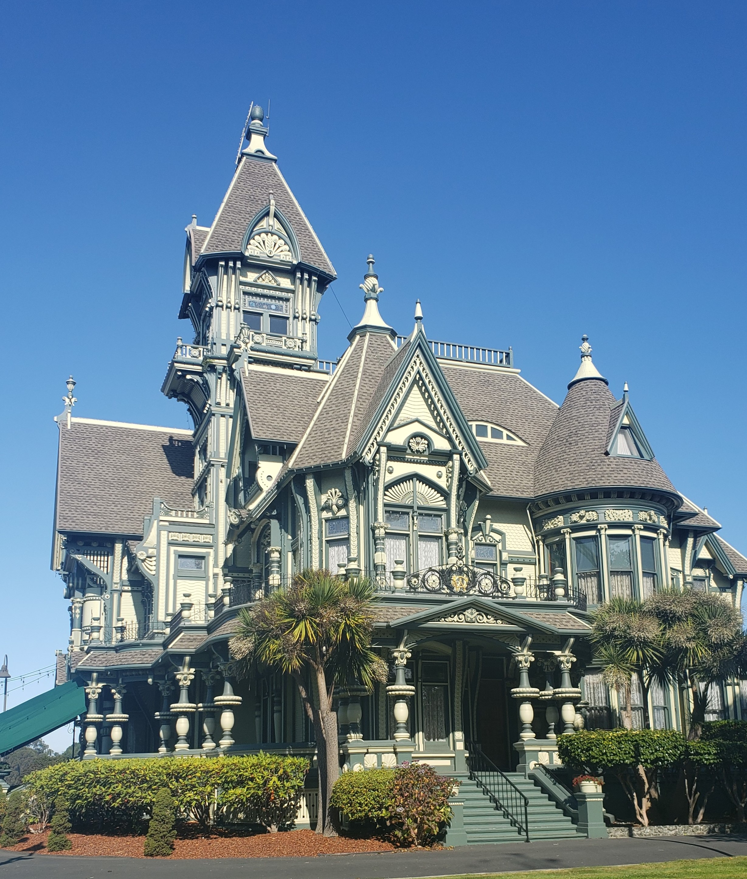 Large gray Victorian style manor