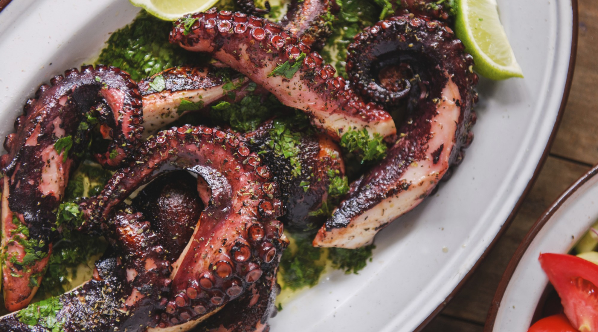 Grilled octopus tentacles with lime and cilantro