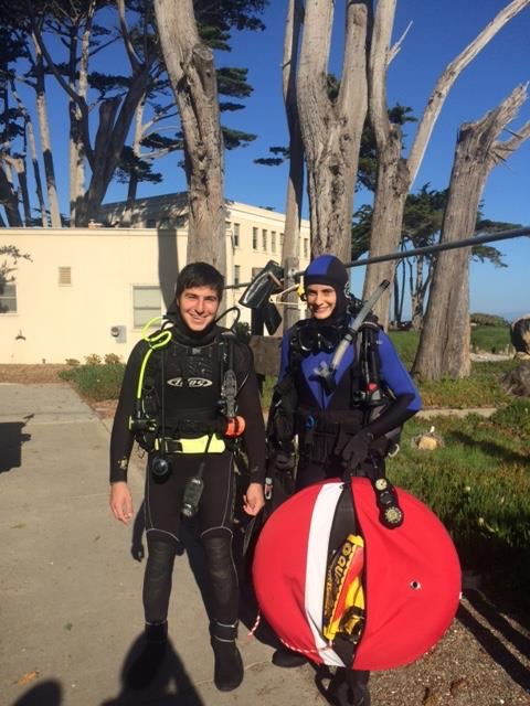 Two researchers standing in scuba diving gear