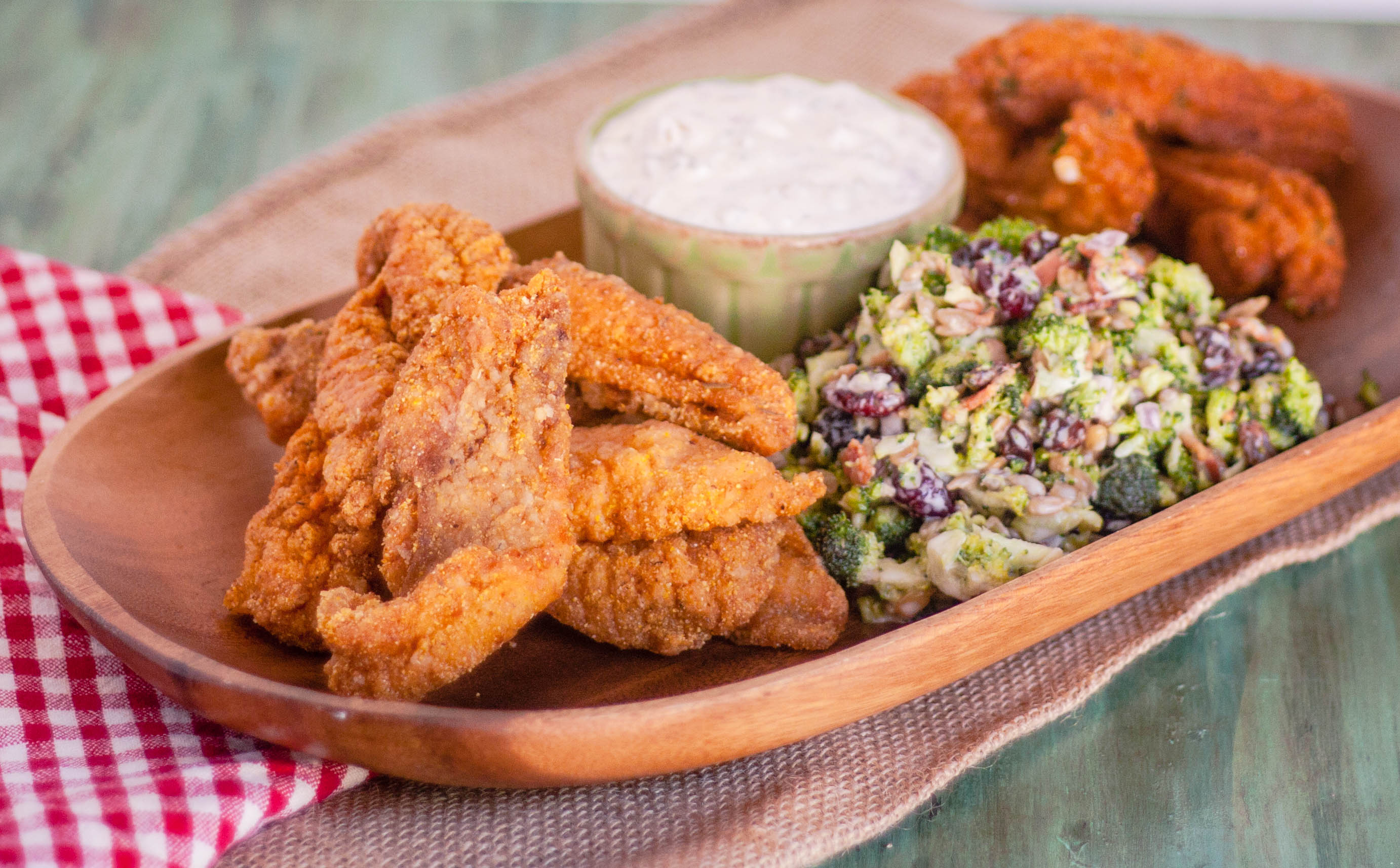 Cajun fried fish with sauce and coleslaw