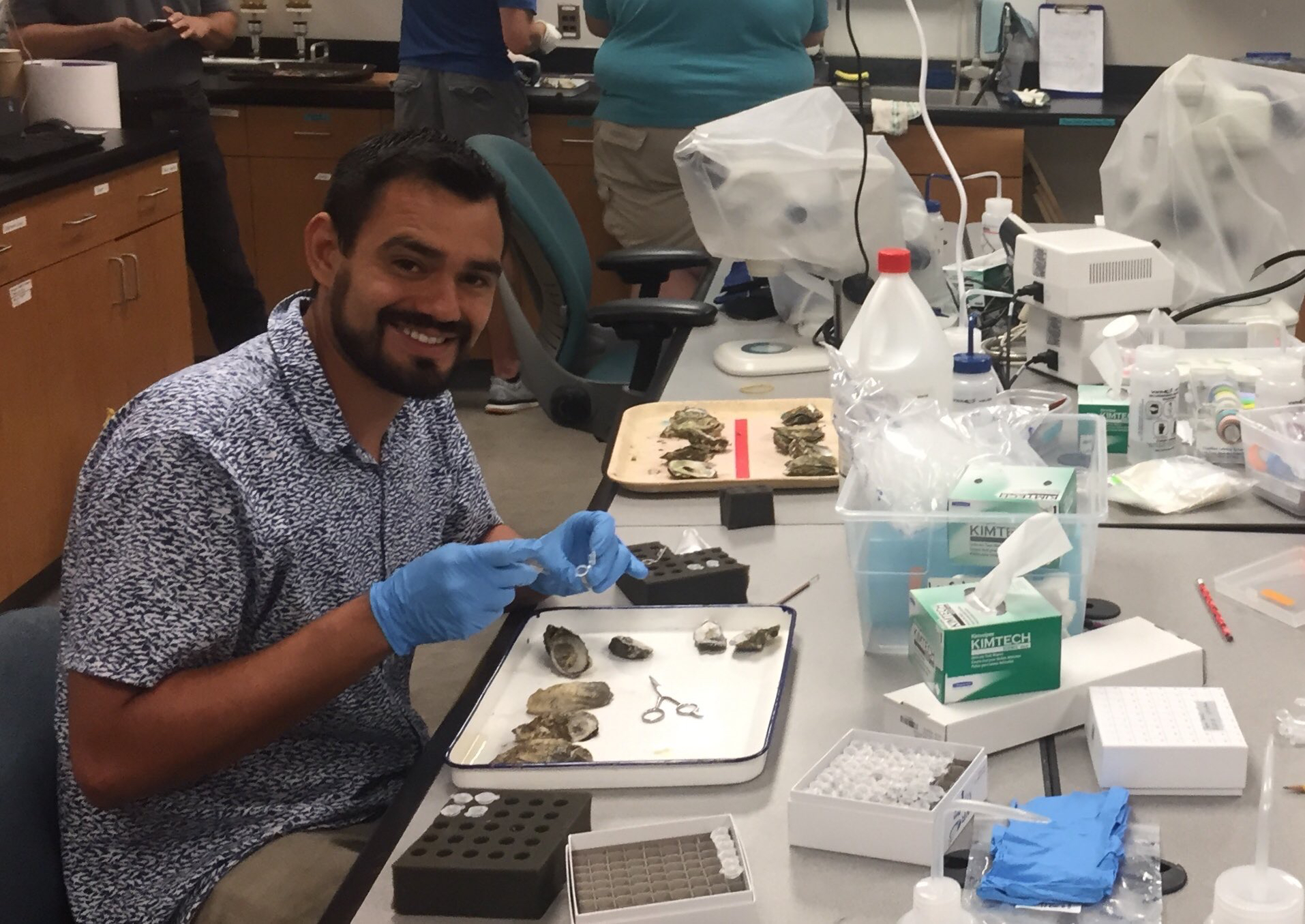 Kevin Johnson dissects oysters in the lab.