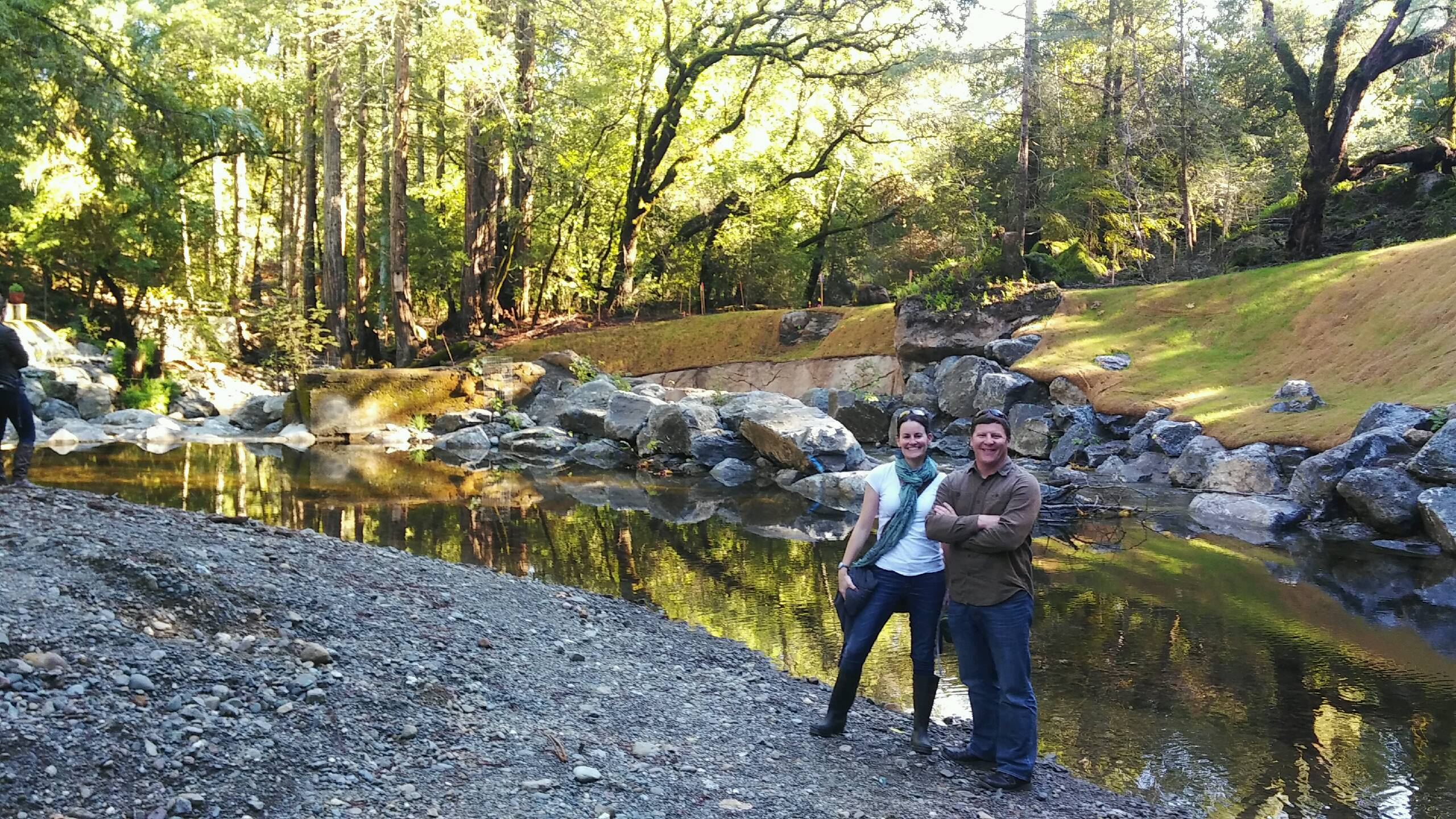 MaryAnn King (TU) and Joe Pecharich (NOAA) stand upstream of the newly-modified dam site on Mill Creek