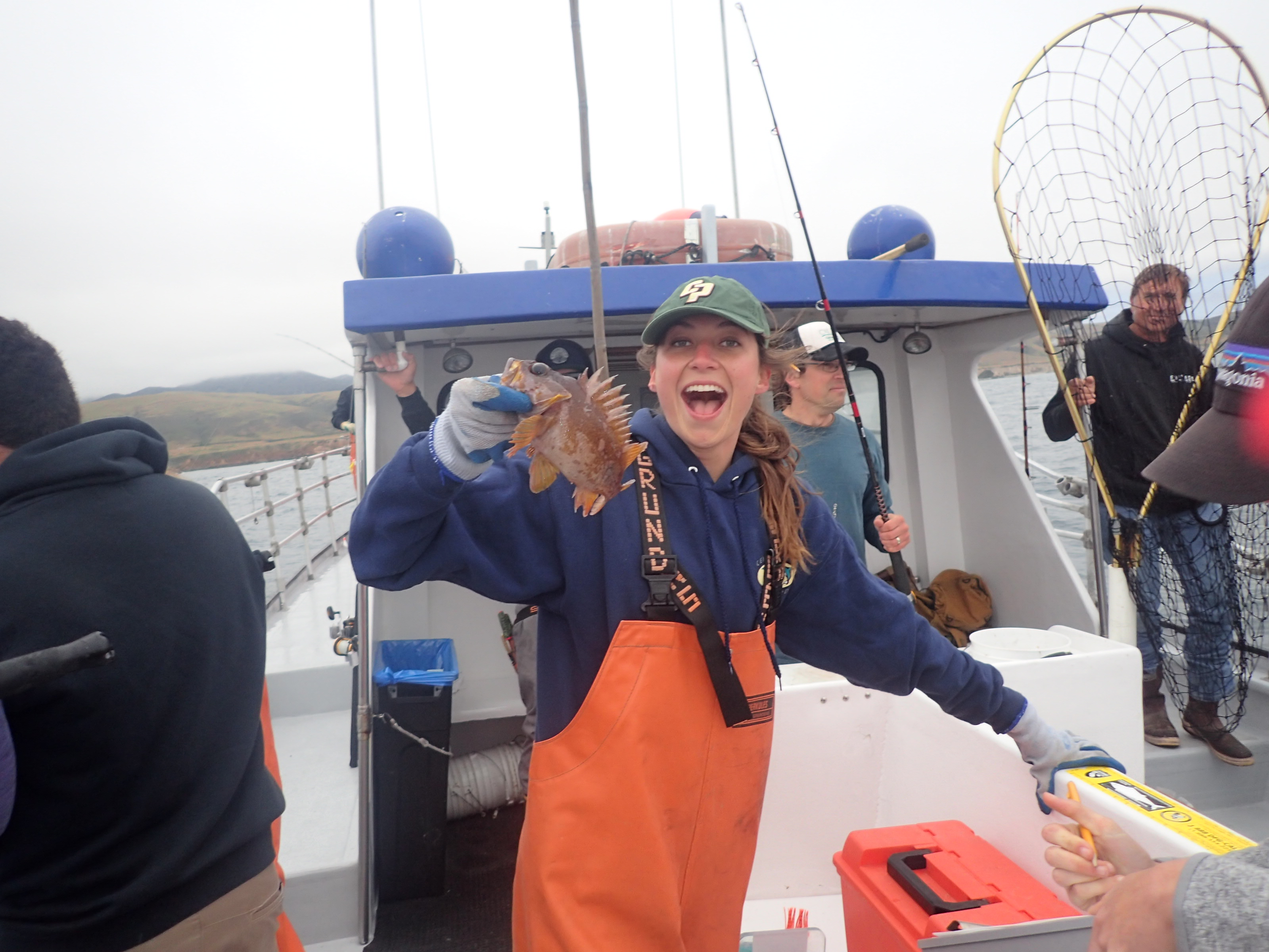 Student Kaleigh Phelps with a tagged cabezon about to be released during MPA monitoring with CCFRP.  Photo courtesy Jennifer O'Leary