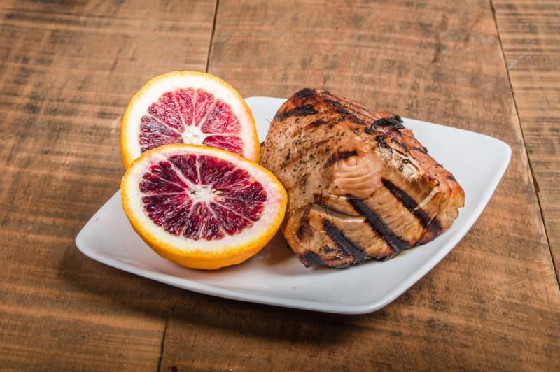 seared fish steak with grapefruit slices