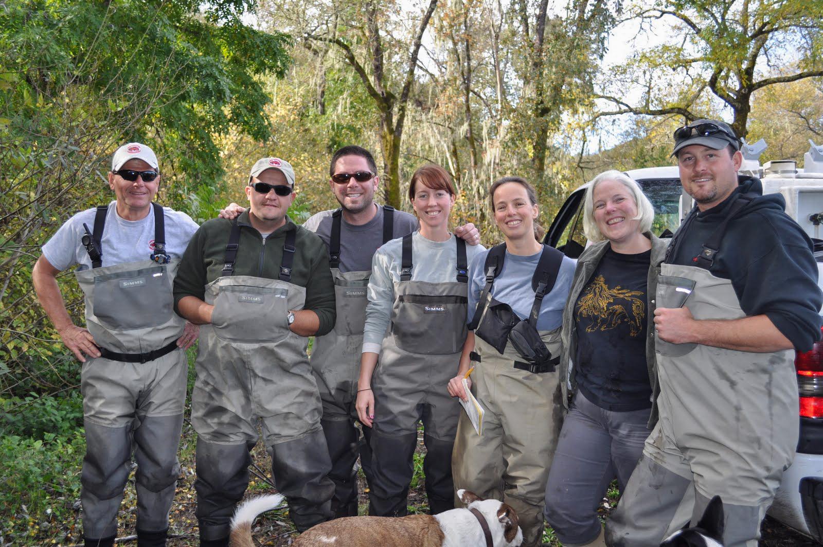 Landowner Sally Weed and members of the coho broodstock team