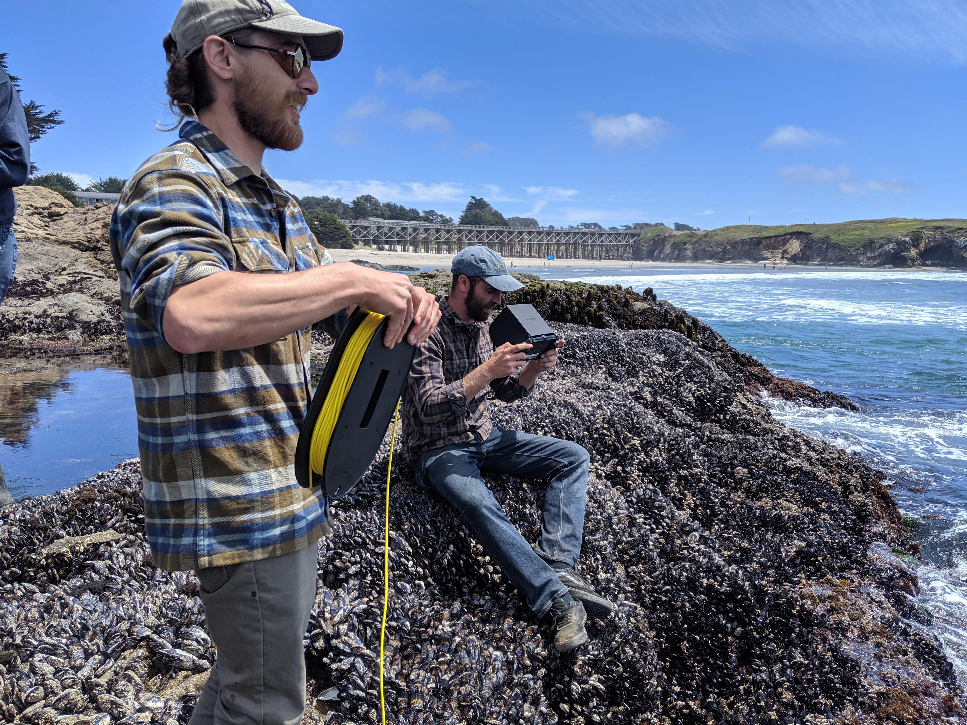 California Sea Grant state fellow Pike Spector and a member of the Mendocino MPA Collaborative put an ROV to work by testing it in typical north coast conditions. Photo credit: Z. Johnson