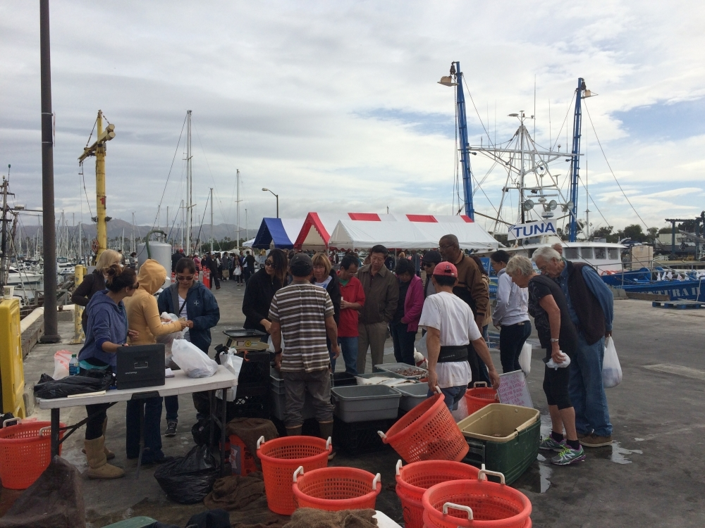 Seafood customers gather around Ventura Harbor