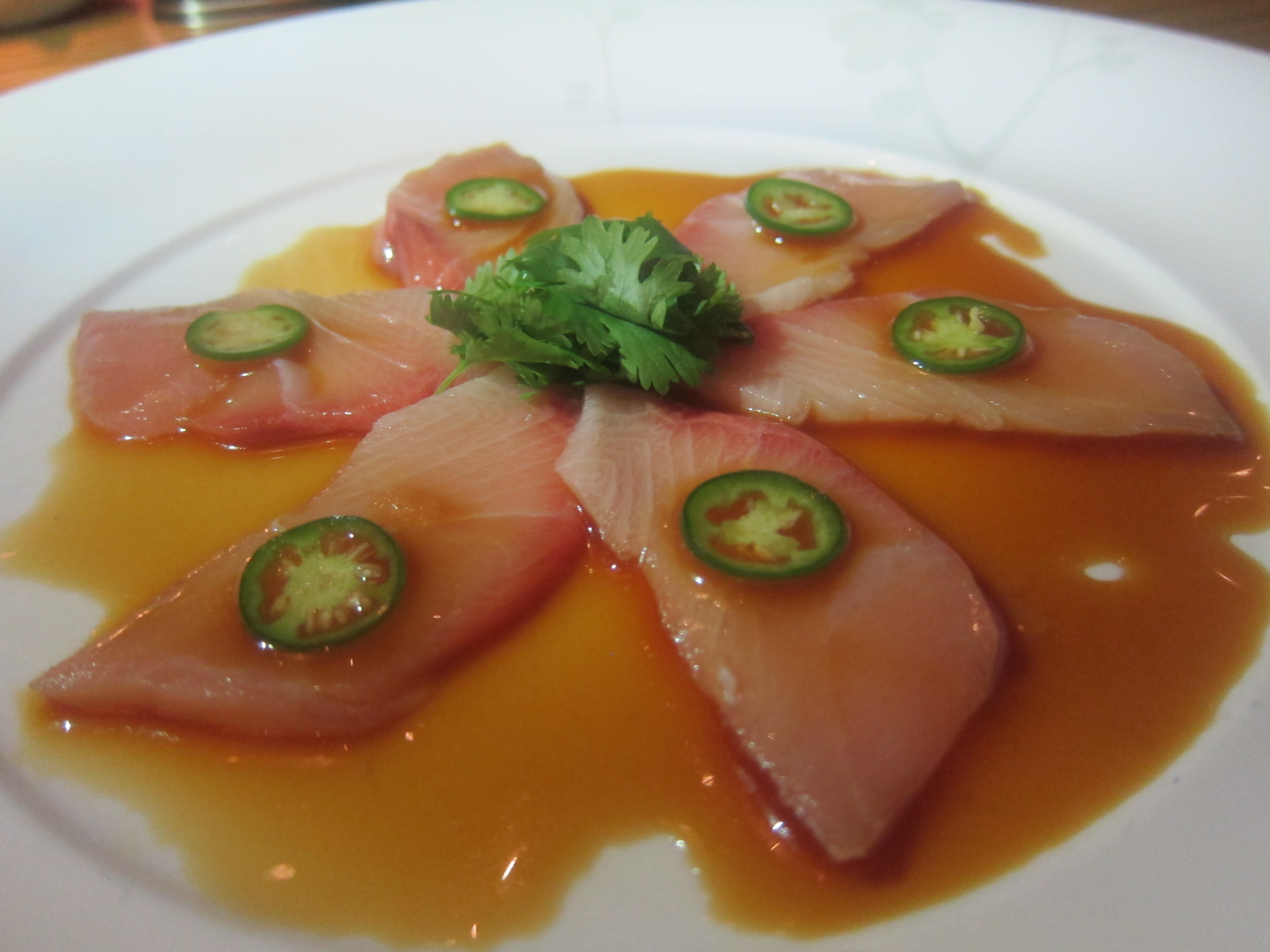 yellowtail sashimi with jalapeno garnish
