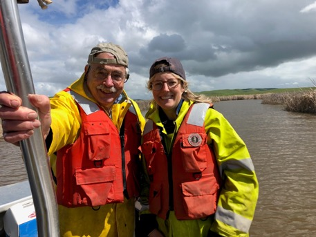 Denise Colombano and her faculty advisor, Dr. Peter Moyle, out on their research vessel sampling fish and invertebrates in Suisun Marsh.