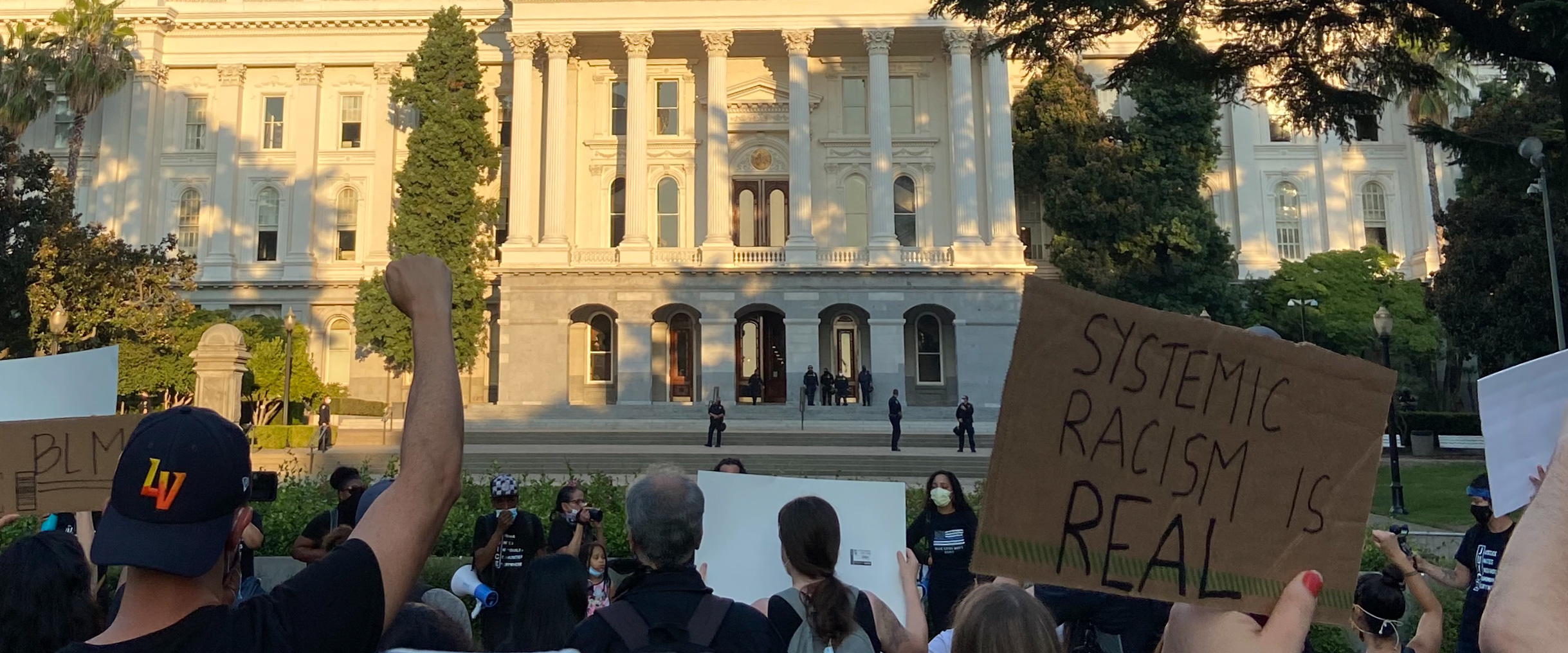 Protestors gathered outside the capitol building in Sacramento
