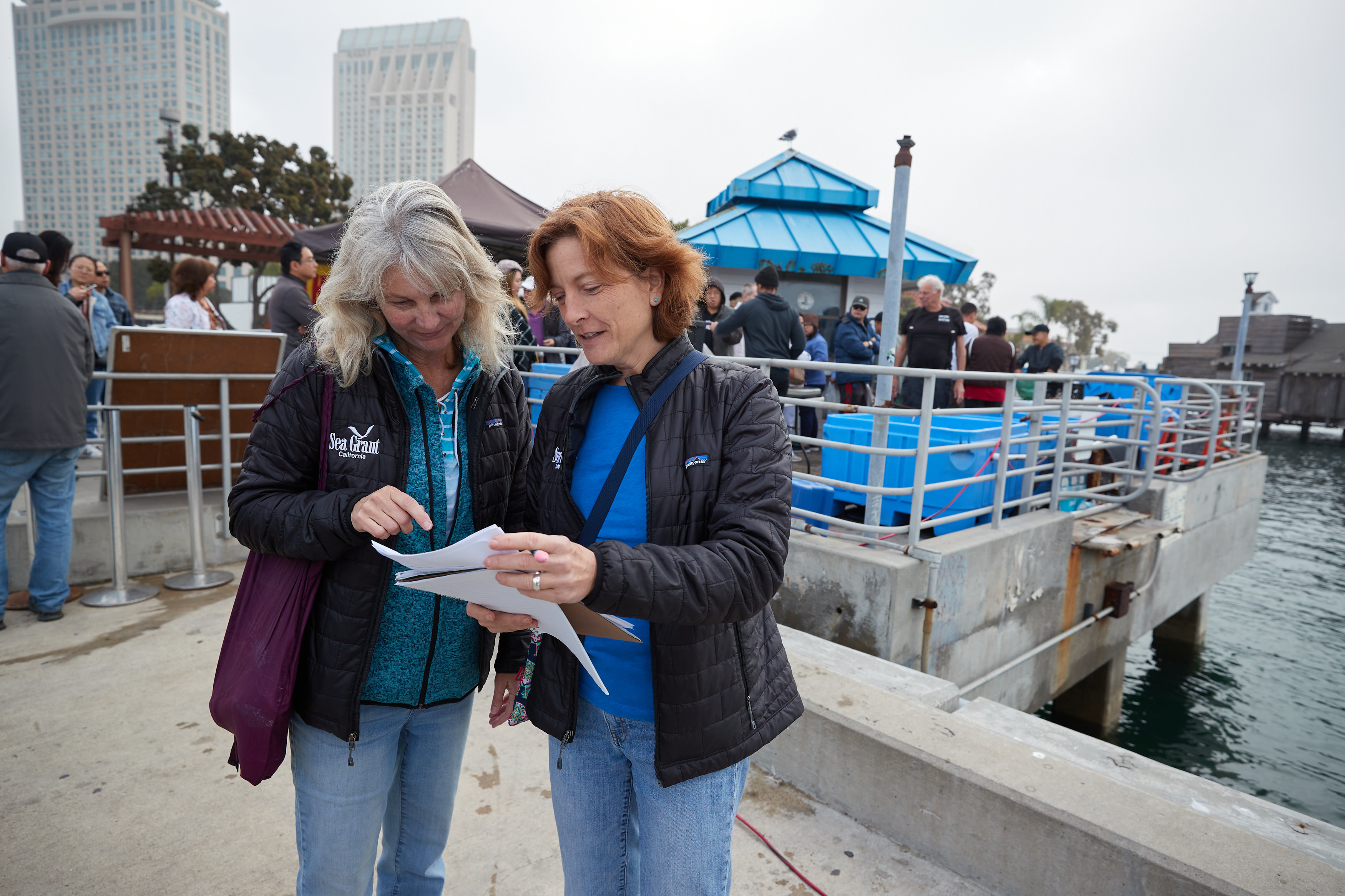 Extension specialists Theresa Talley and Carolynn Culver at the San Diego Tuna Harbor Dockside Market.Photo credit: Fred Greaves
