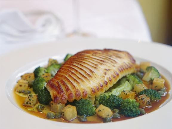 grilled skate wing with potato and broccoli