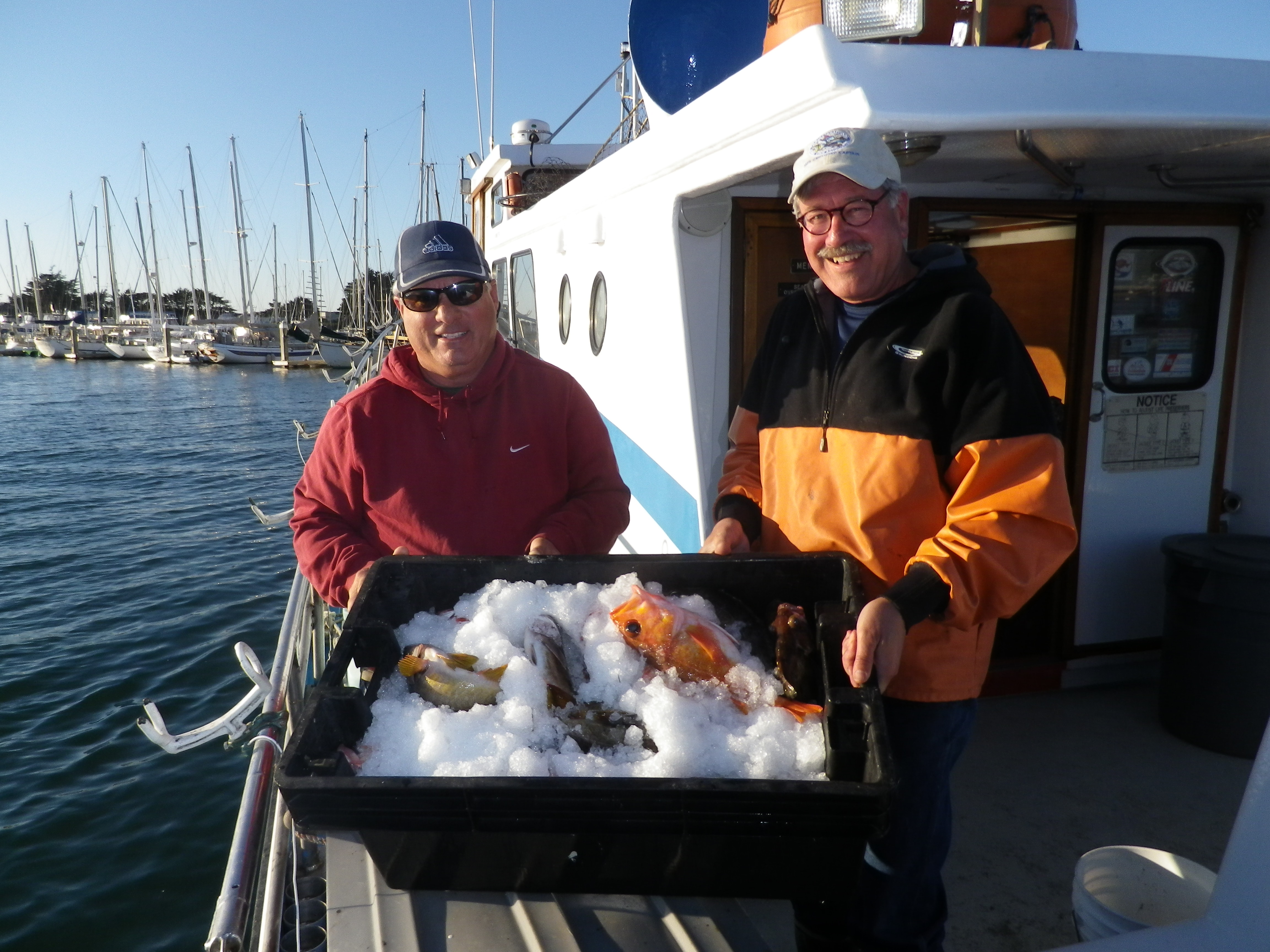 F/V Huli Cat captians Jim Anderson and Tom Mattusch displaying their catch from RCA sampling sites.