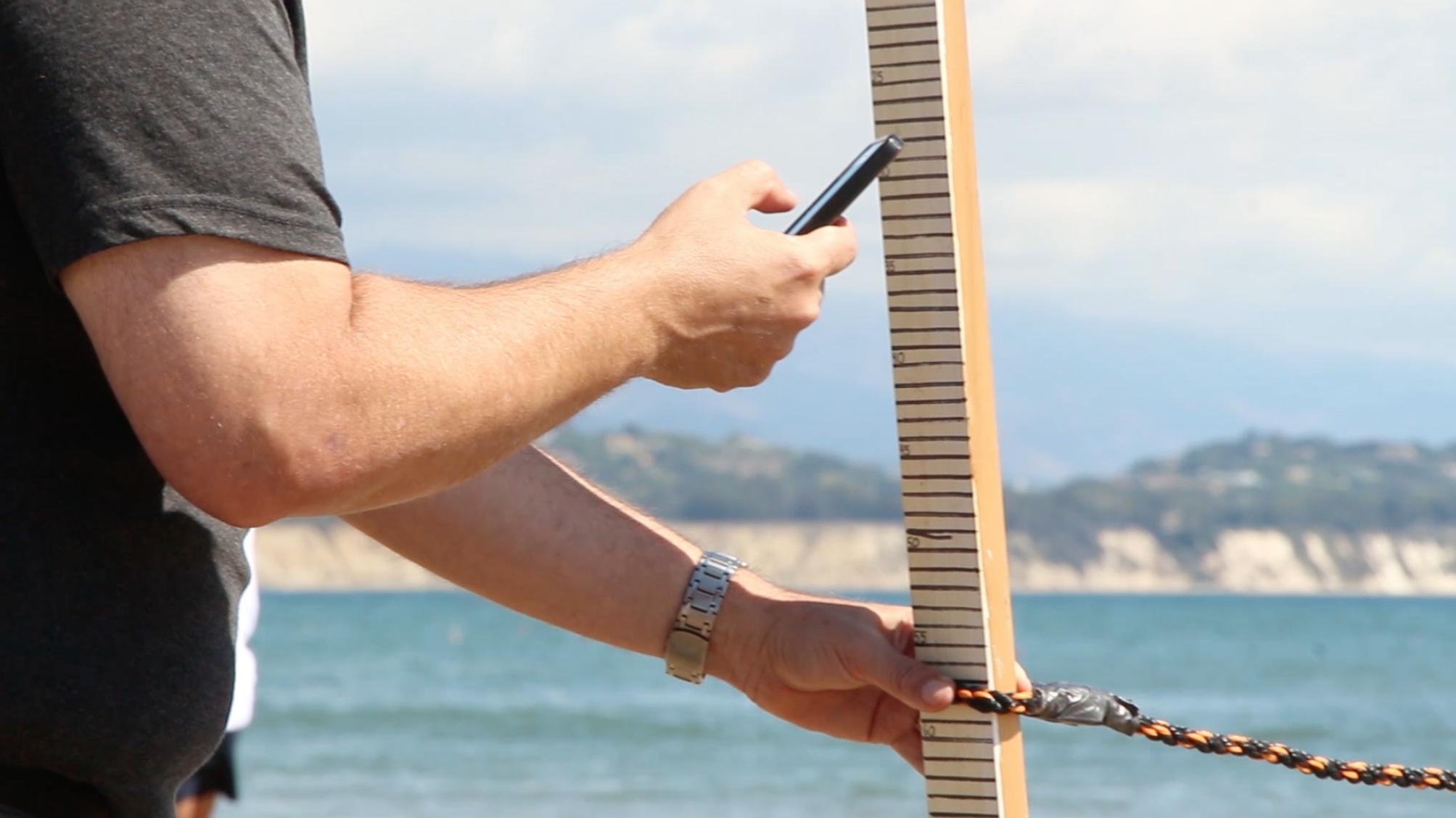 beach survey with phone