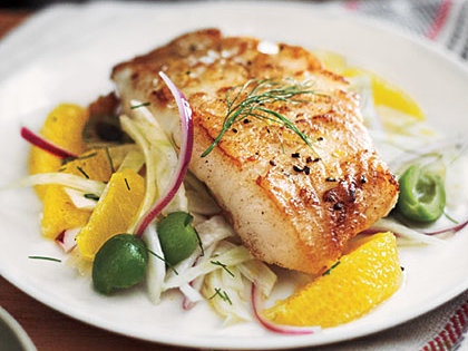 pan-seared seabass with lemon and garnish