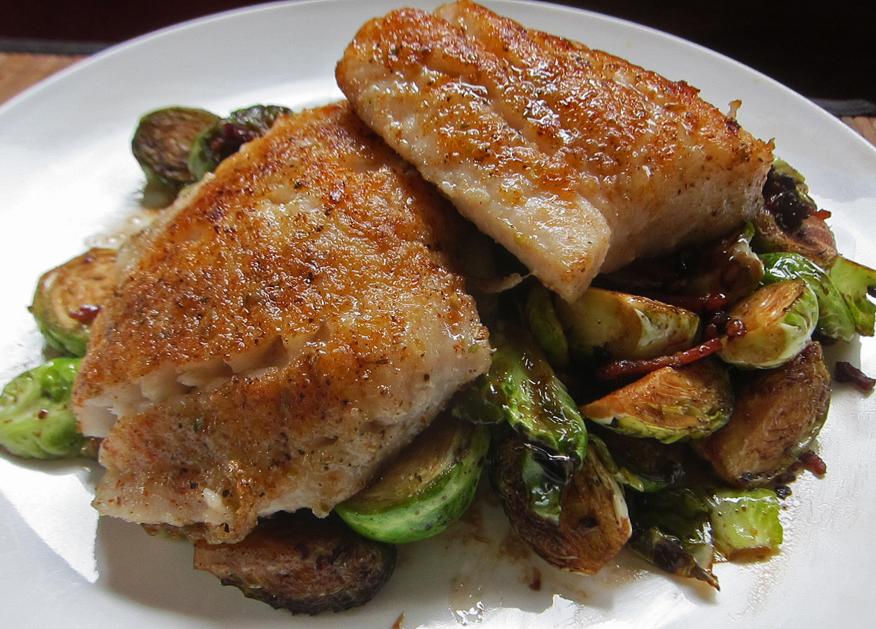 pan-fried sickle pomfret with brussel sprouts and bacon