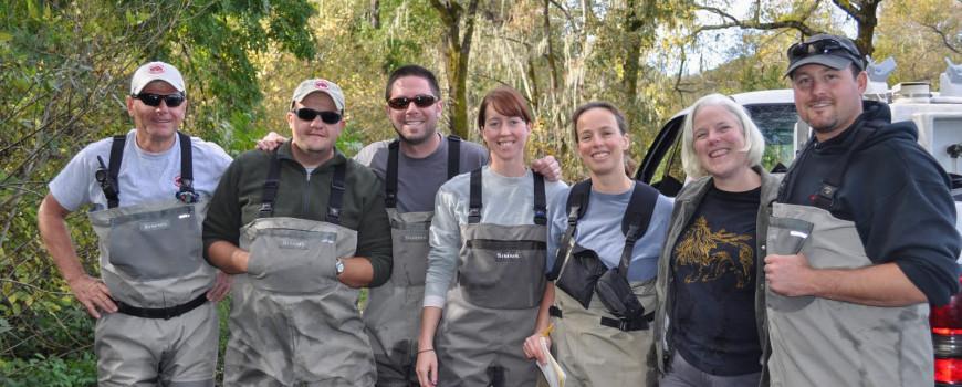 Landowner Sally Weed with members of the coho broodstock program