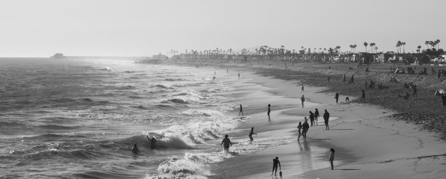 people on beach in california, photo by daniel cabanas