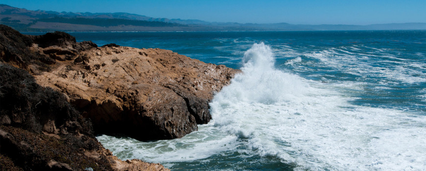 Image of waves hitting a rocky California shoreline. Credit: NOAA