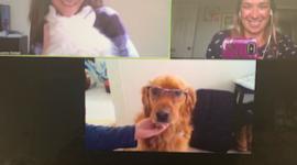 Zoom screenshot of Michaela, a coworker, and a dog