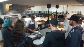 Students watching chef prepare urchins
