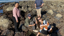 Group of people standing by tide pools