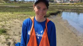 Katie, happy after being knee deep in mud looking for her favorite fish.