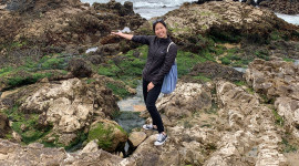 """Taking a break from identifying """"gray"""" coastal armoring structures to examine the tide pools in San Mateo County. Photo credit: Amber Anastacio-Roberts"""