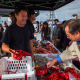 Pictures of chefs, fishermen, and customers at Tuna Harbor Dockside Market
