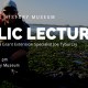 public lecture with joe tyburczy, man standing in eelgrass, shallow water in background
