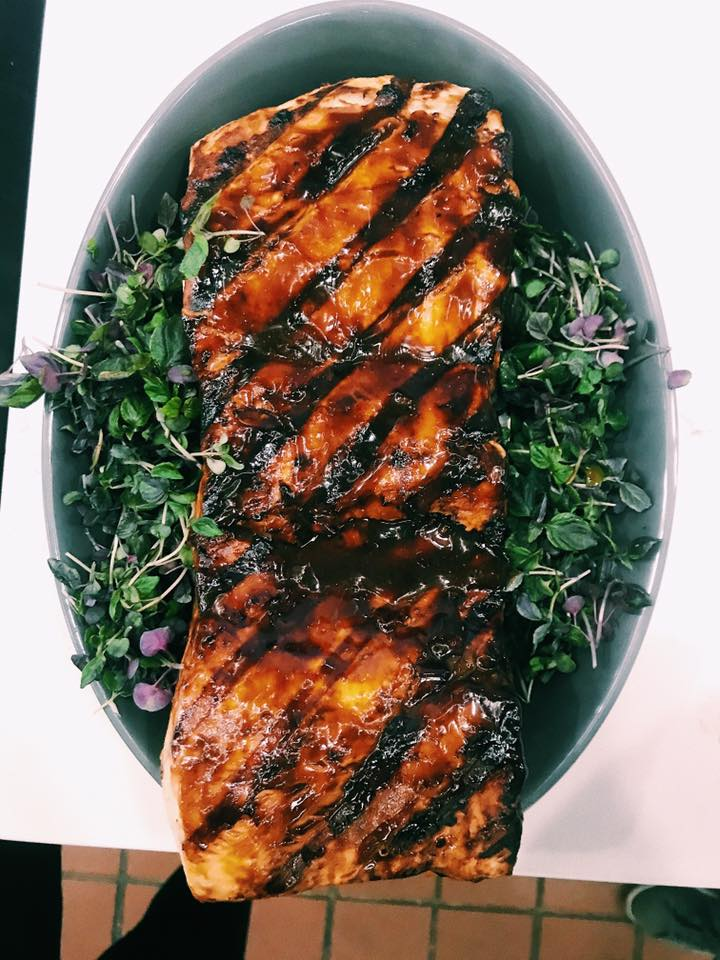 barbequed thresher shark on top a bed of greens