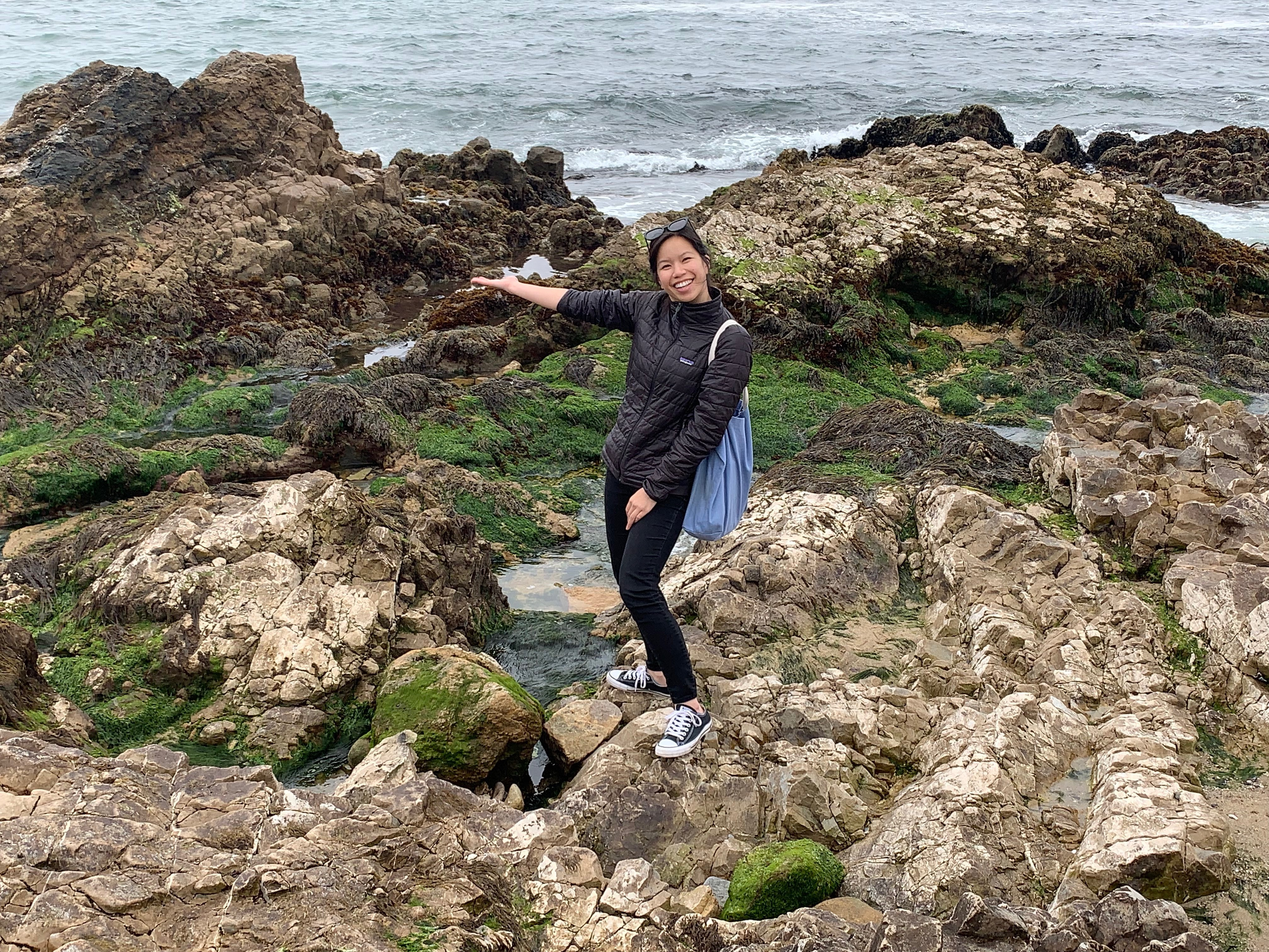 "Taking a break from identifying ""gray"" coastal armoring structures to examine the tide pools in San Mateo County. Photo credit: Amber Anastacio-Roberts"